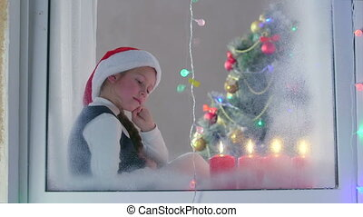 Child waiting Santa on Christmas