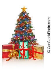Christmas tree isolated with gifts in front - A decorated...