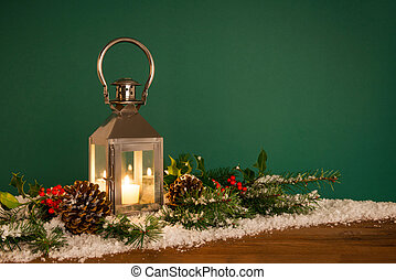 Christmas lantern hooly and snow green background - A...