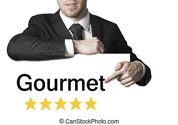 businessman pointing on sign gourmet five stars -...