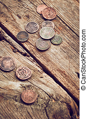 Ancient coins on wooden background