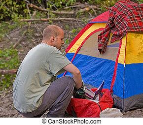 Young Caucasian Man Camping At Tent