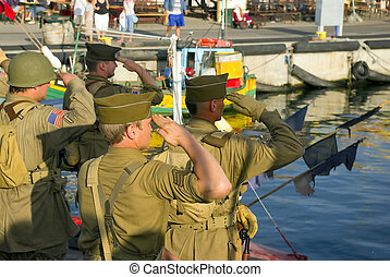 american soldier salut on the pier