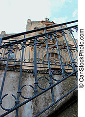 a railing of metal before the church