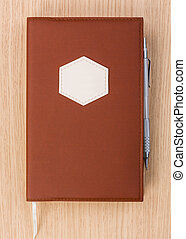 Year business project planner book with pen on wood table