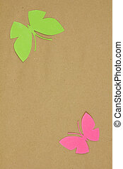 Homemade cardboard butterfly on beige paper. Blank for...