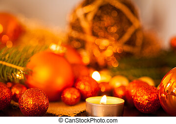 Warm gold and red Christmas candlelight background with...