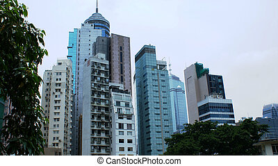 Many skyscrapers in Asia with trees in Hong Kong