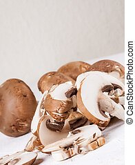 Diced and whole agaricus brown button mushrooms, also known...