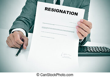 man in suit showing a figured signed resignation document -...