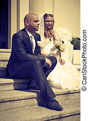 Sitting on the stairs in sephia tones - Nice young couple on...