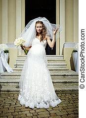 Bride in bridal gown - Nice young woman on wedding day -...