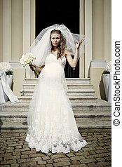Pregnant bride in white - Nice young woman on wedding day -...