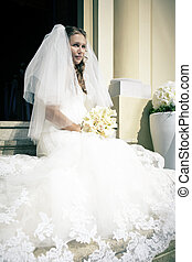 Nice bride on the stairs - Nice young woman on wedding day -...