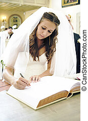 Wedding signature - Nice young woman on wedding day - bride...