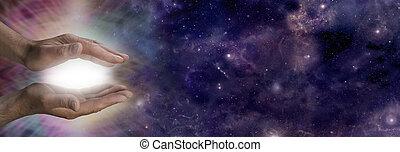 Cosmic healing energy - Male healer with hands held parallel...