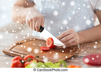 close up of man cutting vegetables with knife - cooking,...