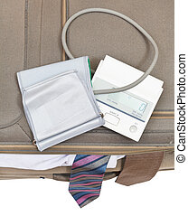 top view of sphygmometer on suitcase with ties - top view of...