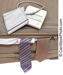 above view of sphygmometer on suitcase with ties - above...