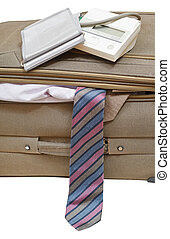 sphygmomanometer on suitcase with ties close up -...