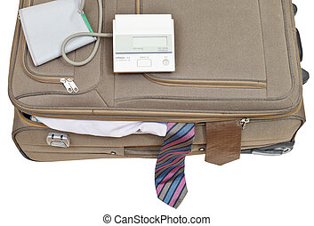 blood pressure monitor on suitcase with male ties isolated...
