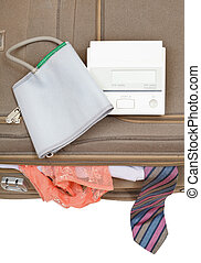 sphygmometer on suitcase with tie and panties - sphygmometer...