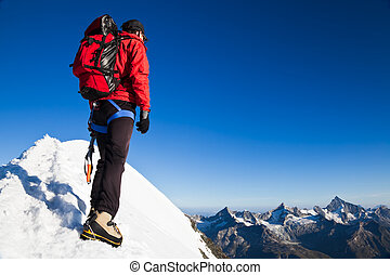 Mountaineer on a snowy ridge - Mountaineer on the snowy...