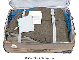 sphygmometer and jacket packed in suitcase isolated on white...