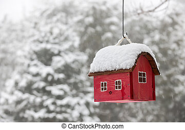 Bird house with snow in winter - Red bird house hanging...
