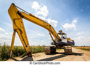 Excavator - Yellow Excavator at Construction Site. Wide...