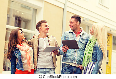 group of smiling friends with tablet pc computers - travel,...