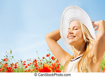 smiling young woman in straw hat on poppy field - happiness,...