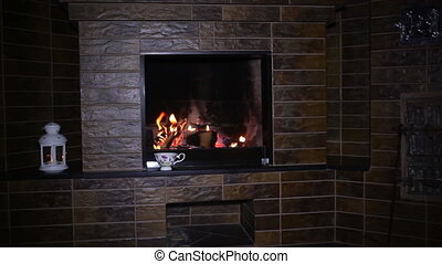 Roaring flames in fireplace - Roaring flames in a modern...