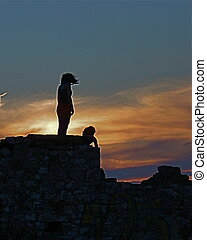 Ancient Greece - The picture shows the silhouette of two...