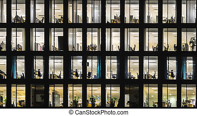 office building at night - Windows of office building at...