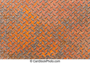 Background of metal diamond plate in red color with rusty