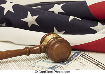 Gavel on Social Security ID ad immigration documents