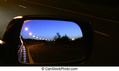 Car mirror view driving at night