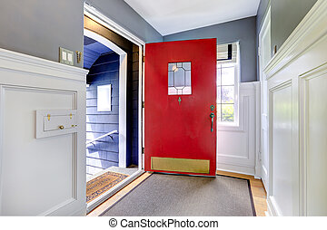 Entrance hallway with open red door - Entrance hallway with...