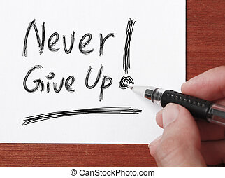 "Never Give Up - Hand with black ballpen is writing "" Never..."