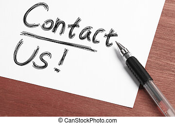 "Contact Us - "" Contact "" Concept written on white paper..."