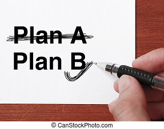 "Business Plan - Hand with black ballpen is writing ""..."