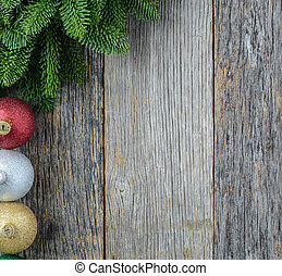 Christmas Pine Needle and Ornaments on a Rustic Wood...
