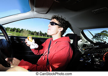 Man driving while eating from a bag