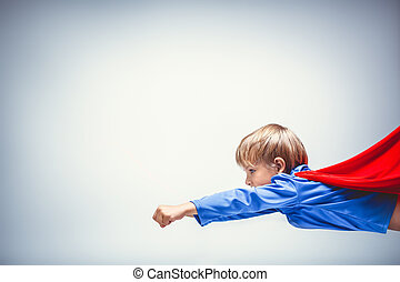 Superman - Flying little superman in studio