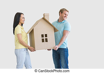 Happiness - Young couple with cardboard house