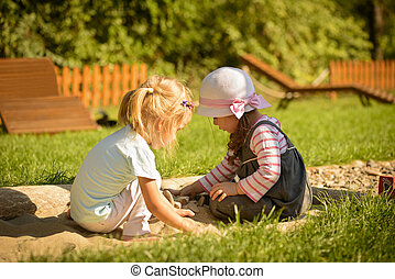 Little girls playing outdoor - Sweet little girls playing in...