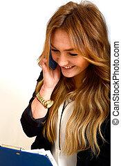 Gesch?ftsfrau - eine junge Gesch?ftsfrau bei einem Telefonat