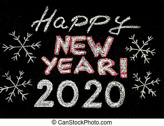 Happy new year 2020, hand writing with chalk on blackboard,...