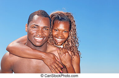 Bright Happy Image of an African Amercian Couple Smiling...